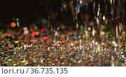Multicoloured glitter gems falling on black background. Стоковое фото, агентство Wavebreak Media / Фотобанк Лори