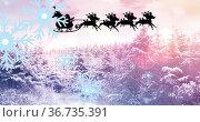 Image of santa in sleigh over christmas winter scenery. Стоковое фото, агентство Wavebreak Media / Фотобанк Лори