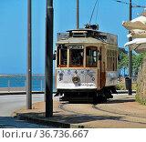 Von Porto in Richtung Foz faehrt diese schoene Strassenbahn der Linie... Стоковое фото, фотограф Zoonar.com/Atlantismedia / easy Fotostock / Фотобанк Лори