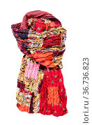 Tied stitched red brown patchwork scarf isolated on white background. Стоковое фото, фотограф Zoonar.com/Valery Voennyy / easy Fotostock / Фотобанк Лори