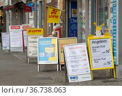 """""""Berlin, Germany - Display stands advertising in front of shops in a shopping street"""" Редакционное фото, агентство Caro Photoagency / Фотобанк Лори"""