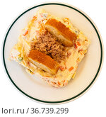 Popular salad of Spanish cuisine called Ensalada rusa. Стоковое фото, фотограф Яков Филимонов / Фотобанк Лори
