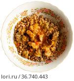 Boiled buckwheat with goulash served with bread. Стоковое фото, фотограф Яков Филимонов / Фотобанк Лори