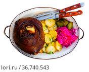 German pork hock with sliced potato and marinaded foods. Стоковое фото, фотограф Яков Филимонов / Фотобанк Лори