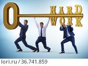 Concept of hard work with key and businessman. Стоковое фото, фотограф Elnur / Фотобанк Лори