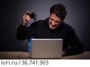 Young male gamer on grey background. Стоковое фото, фотограф Elnur / Фотобанк Лори