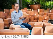 Woman checking pot for plants. Стоковое фото, фотограф Яков Филимонов / Фотобанк Лори