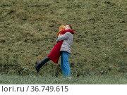Lovers meeting, man and woman hugging outdoors. Стоковое фото, фотограф Евгений Харитонов / Фотобанк Лори