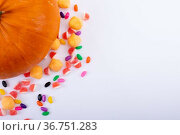 Composition of halloween pumpkin and trick or treat sweets with copy space on white background. Стоковое фото, агентство Wavebreak Media / Фотобанк Лори