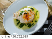 Sepia served with green sauce from garlic and olive oil, served with parsley. Стоковое фото, фотограф Яков Филимонов / Фотобанк Лори