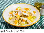 Dish with appetizing chicken salad, eggs and pineapples. Стоковое фото, фотограф Яков Филимонов / Фотобанк Лори