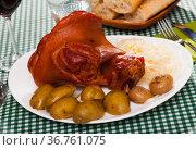 Appetizing baked pork knuckle. Стоковое фото, фотограф Яков Филимонов / Фотобанк Лори