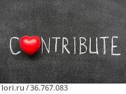 Contribute word handwritten on chalkboard with heart symbol instead... Стоковое фото, фотограф Zoonar.com/Yury Zap / easy Fotostock / Фотобанк Лори