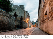 Old cobblestoned street with stone medieval houses in the town centre... Стоковое фото, фотограф Zoonar.com/@jjfarquitectos / easy Fotostock / Фотобанк Лори