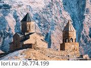 Stepantsminda, Gergeti, Georgia. Famous Gergeti Trinity Tsminda Sameba... Стоковое фото, фотограф Ryhor Bruyeu / easy Fotostock / Фотобанк Лори