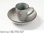 Empty gray ceramic soup plate and empty cup on white table, utensils. Стоковое фото, фотограф Zoonar.com/DANK0 NN / easy Fotostock / Фотобанк Лори