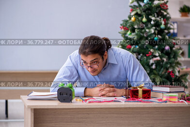 Young male teacher celebrating new year at school