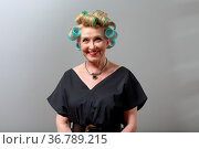 Elderly old aged woman smiling housewife with curlers rollers on hair... Стоковое фото, фотограф Zoonar.com/Max / easy Fotostock / Фотобанк Лори