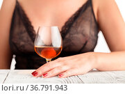 Woman in lingerie sitting at a table and drinking alcohol. Стоковое фото, фотограф Zoonar.com/Photographer: Andrey N.Cherkasov / easy Fotostock / Фотобанк Лори