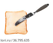 Top view of knife and open sandwich with toast and butter (bread and... Стоковое фото, фотограф Zoonar.com/Valery Voennyy / easy Fotostock / Фотобанк Лори