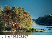 Sweden. Beautiful Red Swedish Wooden Log Cabin House On Rocky Island... Стоковое фото, фотограф Ryhor Bruyeu / easy Fotostock / Фотобанк Лори