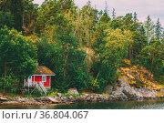Red Finnish Wooden Sauna Log Cabin On Island In Summer. Стоковое фото, фотограф Ryhor Bruyeu / easy Fotostock / Фотобанк Лори