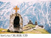 Stepantsminda, Gergeti, Georgia. Cross On Stones On Mountains Background... Стоковое фото, фотограф Ryhor Bruyeu / easy Fotostock / Фотобанк Лори