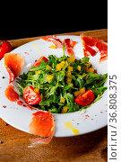 Rocket salad with dried Spanish ham. Стоковое фото, фотограф Zoonar.com/Darius Dzinnik / easy Fotostock / Фотобанк Лори
