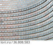 Close up of a curved grey brick wall with raised rows forming a pattern... Стоковое фото, фотограф Zoonar.com/PHILIP_OPENSHAW / easy Fotostock / Фотобанк Лори