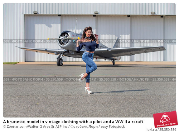 A brunette model in vintage clothing with a pilot and a WW II aircraft. Стоковое фото, фотограф Zoonar.com/Walter G Arce Sr ASP Inc / easy Fotostock / Фотобанк Лори