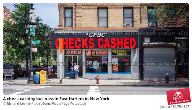 Купить «A check cashing business in East Harlem in New York», фото № 14754827, снято 25 января 2020 г. (c) age Fotostock / Фотобанк Лори