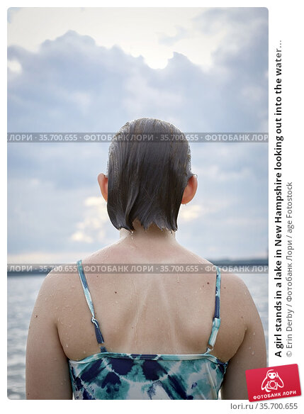 A girl stands in a lake in New Hampshire looking out into the water... Стоковое фото, фотограф Erin Derby / age Fotostock / Фотобанк Лори