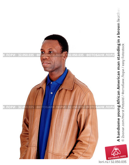 A handsome young African American man standing in a brown leather jacket, waist up, isolated for white background. Стоковое фото, фотограф Zoonar.com/Horst Petzold / easy Fotostock / Фотобанк Лори
