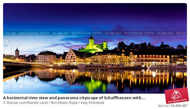 A horizontal river view and panorama cityscape of Schaffhausen with... Стоковое фото, фотограф Zoonar.com/Nando Lardi / easy Fotostock / Фотобанк Лори