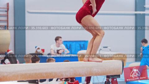 A little gymnastics girl jumping on the bar. Стоковое видео, видеограф Константин Шишкин / Фотобанк Лори
