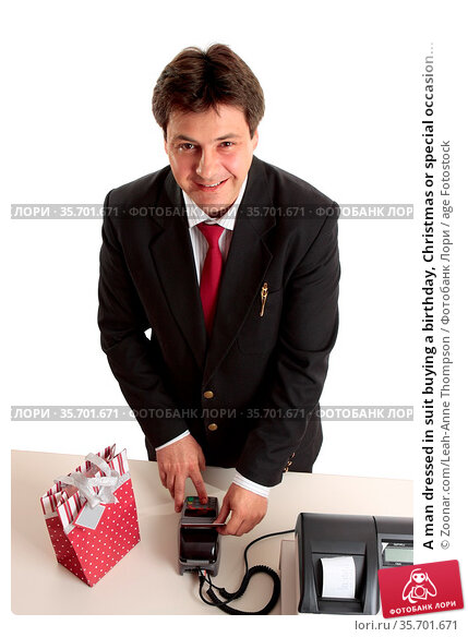 A man dressed in suit buying a birthday, Christmas or special occasion... Стоковое фото, фотограф Zoonar.com/Leah-Anne Thompson / age Fotostock / Фотобанк Лори