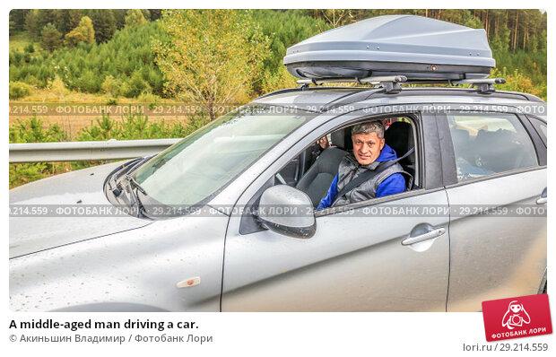 Купить «A middle-aged man driving a car.», фото № 29214559, снято 7 сентября 2017 г. (c) Акиньшин Владимир / Фотобанк Лори