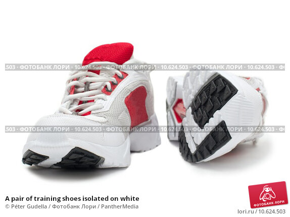 A pair of training shoes isolated on white. Стоковое фото, фотограф Péter Gudella / PantherMedia / Фотобанк Лори
