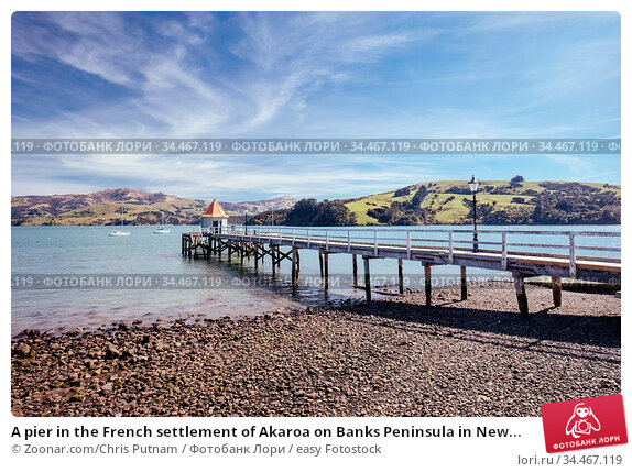A pier in the French settlement of Akaroa on Banks Peninsula in New... Стоковое фото, фотограф Zoonar.com/Chris Putnam / easy Fotostock / Фотобанк Лори