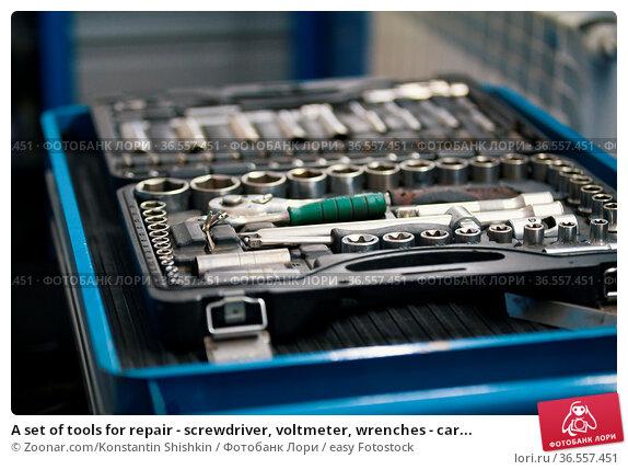 A set of tools for repair - screwdriver, voltmeter, wrenches - car... Стоковое фото, фотограф Zoonar.com/Konstantin Shishkin / easy Fotostock / Фотобанк Лори