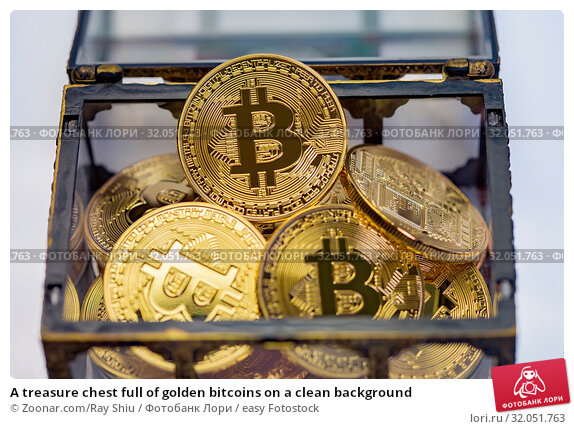 A treasure chest full of golden bitcoins on a clean background. Стоковое фото, фотограф Zoonar.com/Ray Shiu / easy Fotostock / Фотобанк Лори