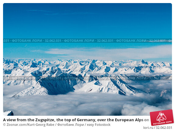 A view from the Zugspitze, the top of Germany, over the European Alps on a sunny day. Стоковое фото, фотограф Zoonar.com/Kurt-Georg Rabe / easy Fotostock / Фотобанк Лори