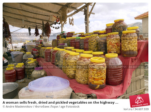 A woman sells fresh, dried and pickled vegetables on the highway ... Стоковое фото, фотограф Andre Maslennikov / age Fotostock / Фотобанк Лори