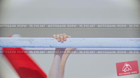 A young person exercising on the gymnastic bars. Стоковое видео, видеограф Константин Шишкин / Фотобанк Лори