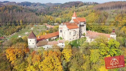 Купить «Above view of medieval castle Pernstein. South Moravian region. Czech Republic», видеоролик № 33673043, снято 15 октября 2019 г. (c) Яков Филимонов / Фотобанк Лори