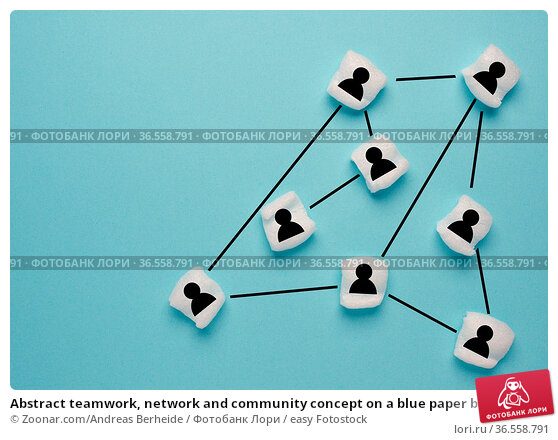 Abstract teamwork, network and community concept on a blue paper background... Стоковое фото, фотограф Zoonar.com/Andreas Berheide / easy Fotostock / Фотобанк Лори