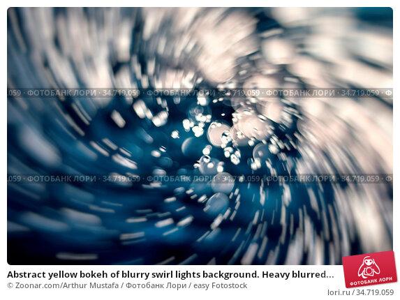 Abstract yellow bokeh of blurry swirl lights background. Heavy blurred... Стоковое фото, фотограф Zoonar.com/Arthur Mustafa / easy Fotostock / Фотобанк Лори