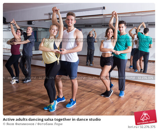 Купить «Active adults dancing salsa together in dance studio», фото № 32276375, снято 24 января 2020 г. (c) Яков Филимонов / Фотобанк Лори