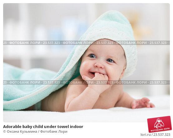 Купить «Adorable baby child under towel indoor», фото № 23537323, снято 7 октября 2015 г. (c) Оксана Кузьмина / Фотобанк Лори