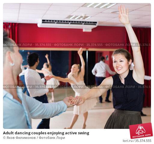Adult dancing couples enjoying active swing. Стоковое фото, фотограф Яков Филимонов / Фотобанк Лори